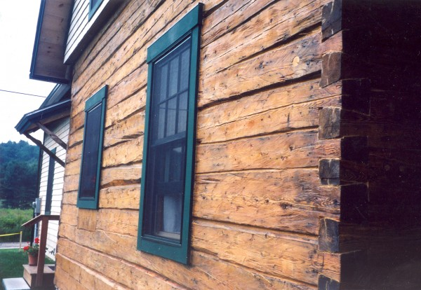 Swedish log houses are characterized by hand-hewn timbers rounded on the top and concave on the bottom so they fit tightly together.
