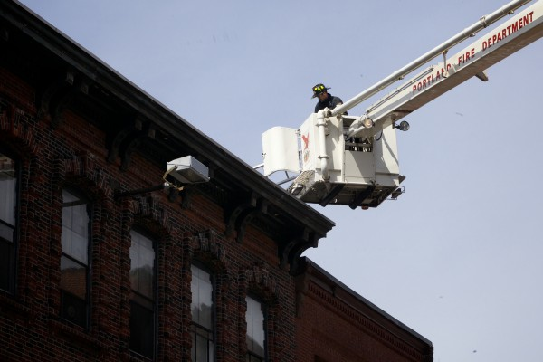 Portland firefighters respond to a two-alarm fire at 86 Exchange St. in the city's Old Port Monday morning. The fire is believed to have started in the basement.