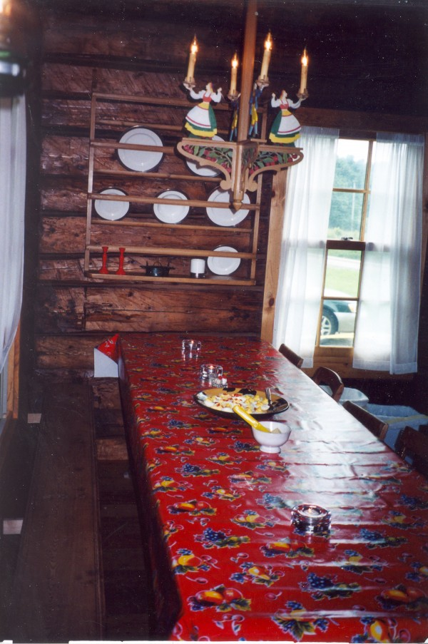 The interior of the Johnsons' log house is inspired by the design of the Carl Larsson home they visited in Sweden.