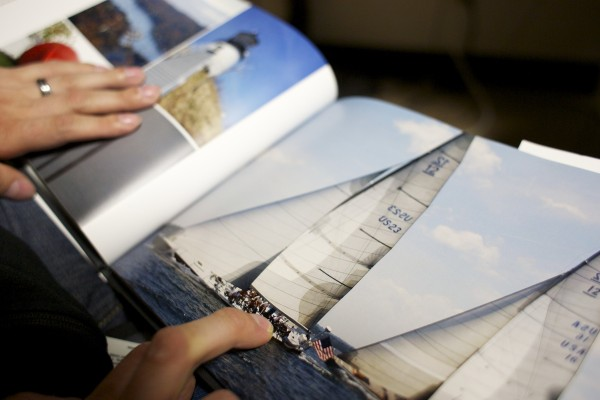Derek O'Brien looks over an image of a sailboat he photographed while at a camp for disabled people in Rhode Island. O'Brien will be graduating from University of Maine in Orono in May 2013. He uses photography as a way to be creative from the confines of his wheelchair.