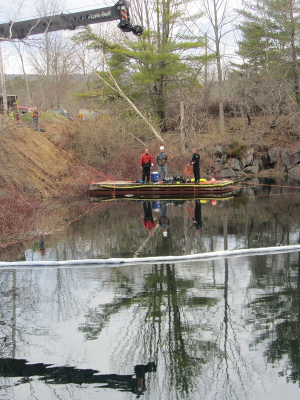 A car that drove into the Simonton Corner Quarry Nature Preserve in Rockport on April 13 prepared to be pulled out of the water-filled quarry