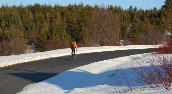 On nice days, there is pavement and sun to be had for cycling in northern Maine. You just need to bundle up.
