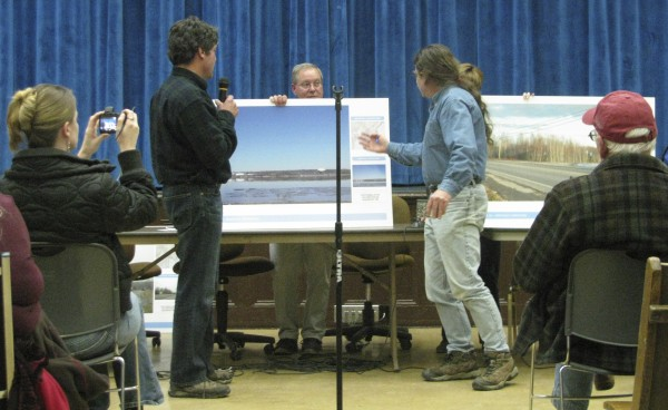 David Graham (left) of DCP Midstream debates the aesthetics of his company's proposed propane terminal project with Peter Taber (right) of Searsport at a 2012 meeting.