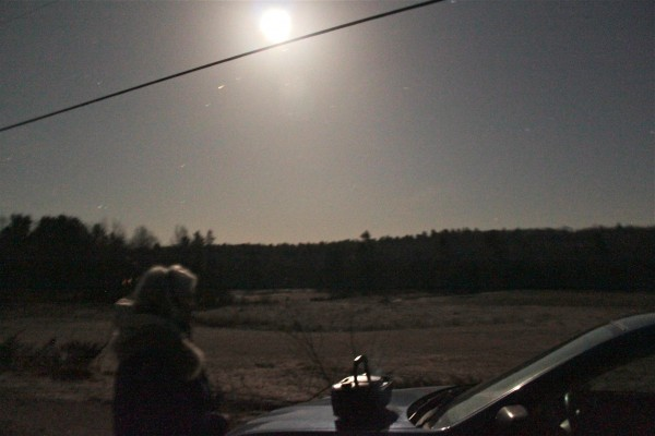 Corelyn Senn of Lincolnville stands beside her car at about 3 a.m. on Easter, March 31, 2013, listening for owls for the Maine Owl Monitoring Project.