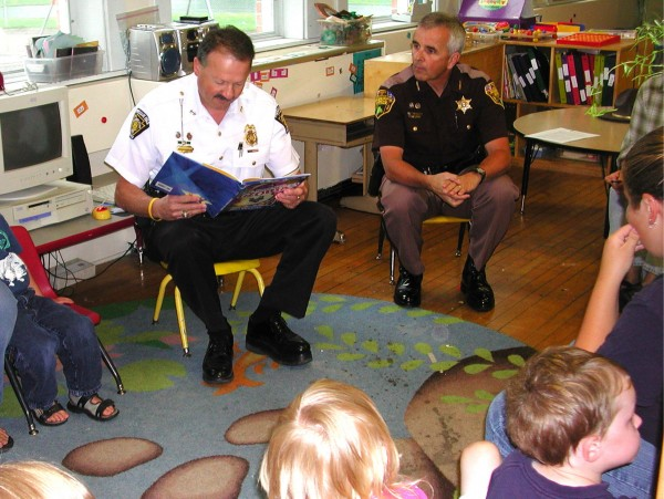 Presque Isle Police Chief Naldo Gagnon (left) and Aroostook County Sheriff James Madore spent some time with Head Start students at the Aroostook County Action Program's Child and Family Services Center in Presque Isle. Gagnon read &quotOfficer Buckle and Gloria,&quot a children's book offering safety tips from a police officer and his canine partner, Gloria.