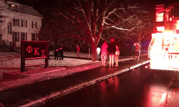 Students huddle outside the Phi Kappa Sigma fraternity on College Avenue in Orono after being evacuated due to a fire in the building Friday evening.
