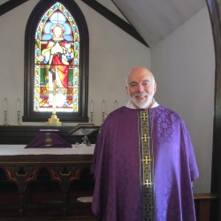 New priest at Palmyra church a loving, enthusiastic hugger