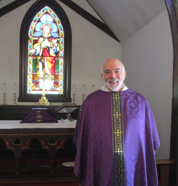 Rev. Levering P. Sherman stands at the altar of St. Thomas' Episcopal Church in Winn. He serves as priest-in-charge at St. Thomas and St. Andrew's Episcopal Church in Millinocket.