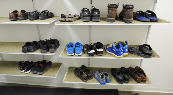 Men's shoes sit in a small room off the entrance of the Islamic Center of Maine in Orono on Saturday