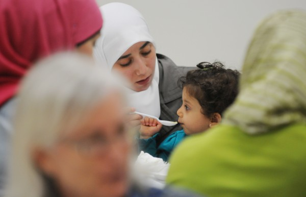 Muslim and non-Muslim women share a meal at the Islamic Center of Maine in Orono on Saturday after prayer. The Center hosts the potluck to encourage non-Muslims to learn more about the Islamic faith.