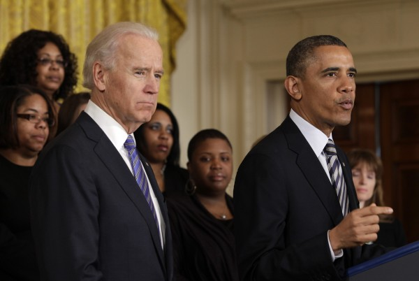 With Vice President Joe Biden, left, President Barack Obama talks about protecting children from gun violence in Washington on March 28, 2013.