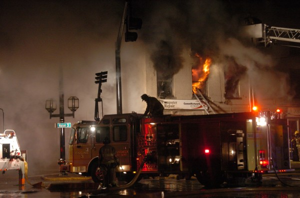Flames consume the second story above Communication Network at 45 Maine St., on April 17, 2011. Becky and Phil Doughty now run their business from their Topsham home.