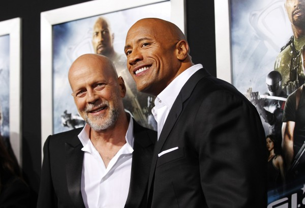 Cast members Dwayne Johnson (right) and Bruce Willis pose at the premiere of &quotG.I. Joe: Retaliation&quot in Hollywood on March 28, 2013.