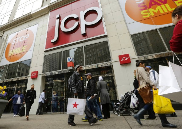 Shoppers walk past the J.C. Penney's store in New York in this file photo taken April 11, 2013.  U.S. retail sales contracted in March for the second time in three months and consumer confidence tumbled in April, a sign that tax hikes early this year have stolen momentum from the American economy.
