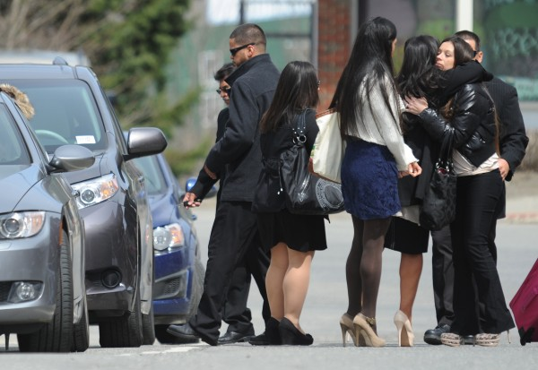 Tonya Perdomo (right), widow of Jerry Perdomo, exchanges hugs with family members on a Belfast street after leaving Waldo County Superior Court in Belfast. Daniel Porter was sentenced in the February 2012 shooting death of Jerry Perdomo during a heated argument about a drug debt. Porter received 16 years with 4 years probation when he is released for the death of the former Florida firefighter.