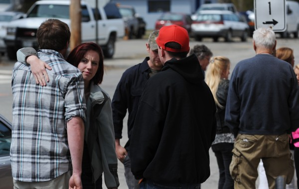 Supporters of Daniel Porter embrace outside of the Waldo County Superior Court in Belfast on Monday. Daniel Porter was sentenced in the February 2012 shooting death of Jerry Perdomo during a heated argument about a drug debt. Porter received 16 years with 4 years probation when he is released for the death of the former Florida firefighter.