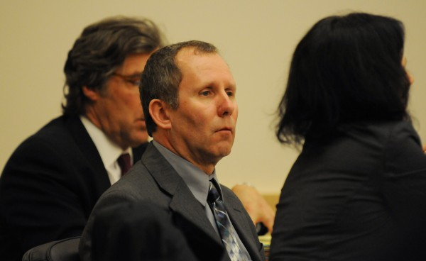 Peter Robinson sits between his attorneys Thomas Hallet (left) and Molly Bailey Butler as Assistant Attorney General Andrew Benson gives his closing remarks to the jury in Robinson's murder trial on Monday at the Penobscot Judicial Center in Bangor.