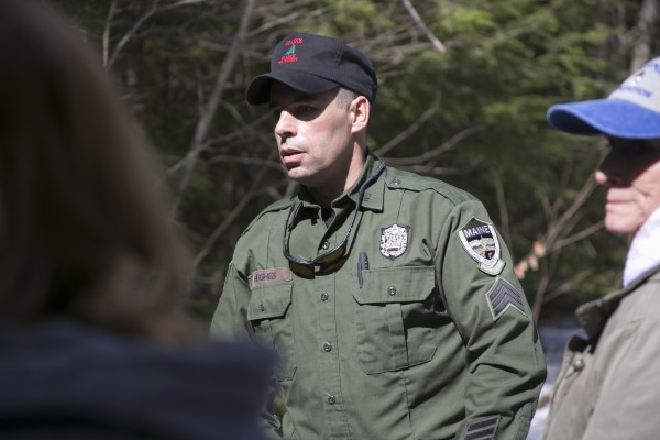 Sgt. Terry Hughes Jr. of the Maine Warden Services addresses media as they approach the campsite of Christopher Knight. The landowner did not allow media to travel to the campsite.