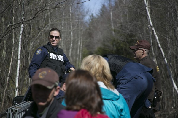 Maine State Police Trooper Diane Vance and other law enforcement officers lead media onto private property to Christopher Knight's campsite.