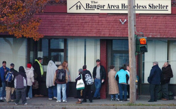Dozens of people congregate outside the Bangor Area Homeless Shelter on Main Street in Bangor on a Friday morning in November 2009.