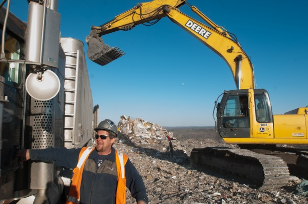 Workers offload trash at the Juniper Ridge Landfill in Old Town on Wednesday, January 23, 2013.