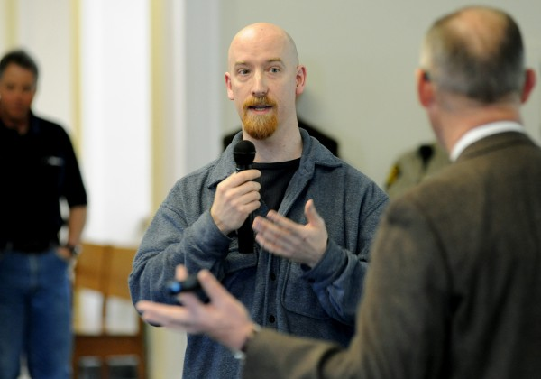 Opponent to the proposed east-west corridor, Matthew Newman of Garland, makes his opinion heard while having his chance to speak with Peter Vigue, chairman and CEO of Cianbro Corp., at a meeting to update the Commissioners that was open to the public. The meeting was held on Tuesday at the historic Penobscot County Courthouse.