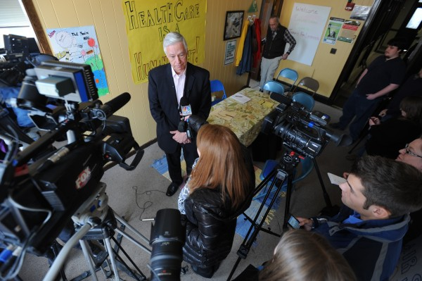 Congressman Mike Michaud speaks to the media after listening to a group of Mainers without health insurance at the offices of the Maine People's Alliance in Bangor on Monday.