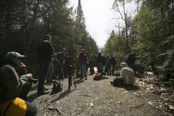 Media waits hundreds of yards away from the campsite of Christopher Knight. The landowner contacted the state police and requested media not be allowed to view the site.