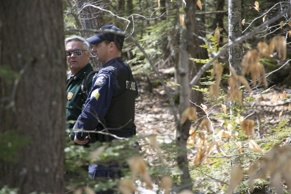 Sgt. Peter Michaud of the Maine State Police waits on the perimeter of Christopher Knight's campsite while other law enforcement officers collected evidence from the camp.