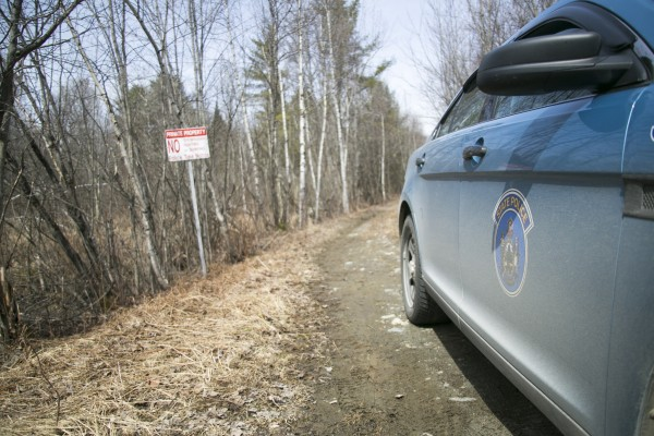A Maine State Police cruiser parked at the end of a dirt road that lead to the site of Christopher Knight's campsite. The landowner did not allow media to visit the site.