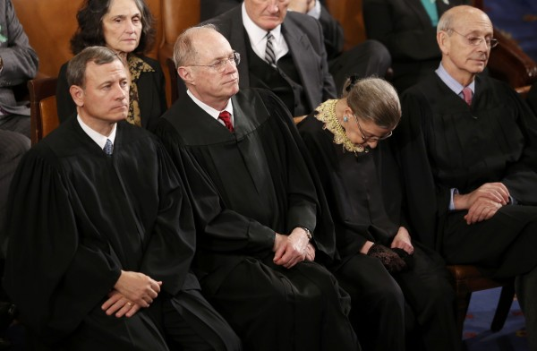 U.S. Supreme Court Chief Justice John Roberts, left, and Associate Justices Anthony Kennedy, Ruth Bader Ginsburg and Stephen Breyer listen as U.S. President Barack Obama delivers his State of the Union speech on Capitol Hill in Washington, February 12, 2013.