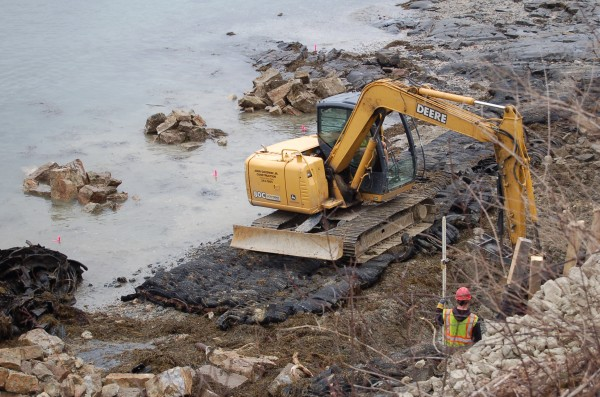 Construction crews rebuilding a more than century old sea wall in Bar Harbor this winter and spring used large blasting mats -- rubber tires tied together with steel cables -- to protect the beach ecosystem as they worked.