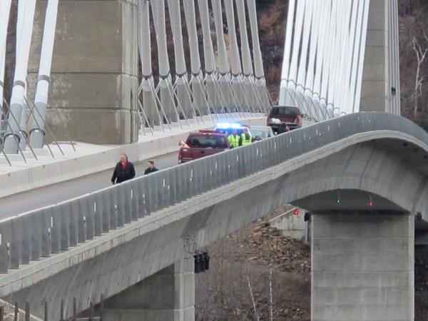 Law enforcement and emergency responders converged on the Penobscot Narrows Bridge around noon Monday, April 1, 2013, after a man jumped off the bridge in an apparent attempt at suicide.