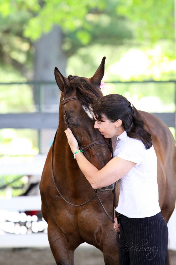 Finding ways to communicate with horses -- Like Cassie Astle is trying to do here, with Raffles -- is a constant challenge for trainers and riders.