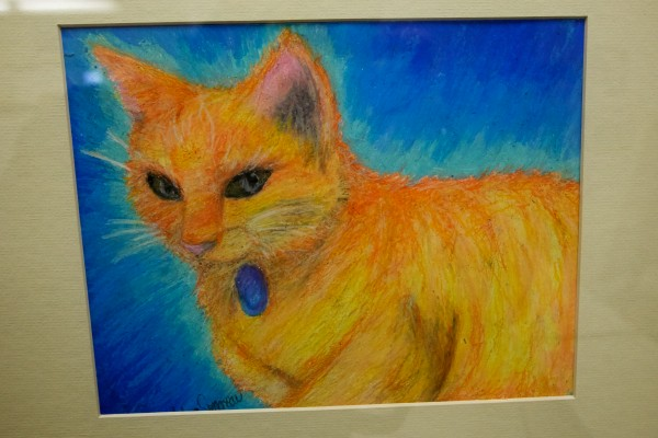 Detail of &quotSweet Soft Kitten&quot by Westbrook High School student Victoria Simoneau hangs in a show in Westbrook dedicated to Simba the cat, who has hung around the school for 13 years.