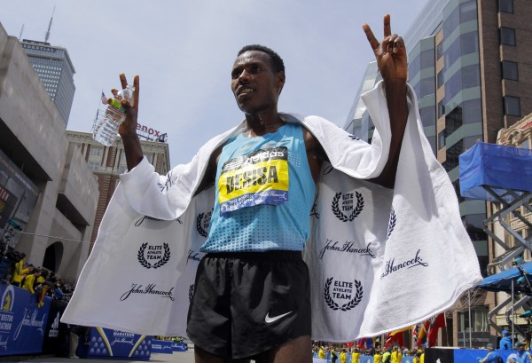 Men's division winner Lelisa Desisa Benti of Ethiopia poses for a photo after winning the men's division of the 117th Boston Marathon in Boston on Monday