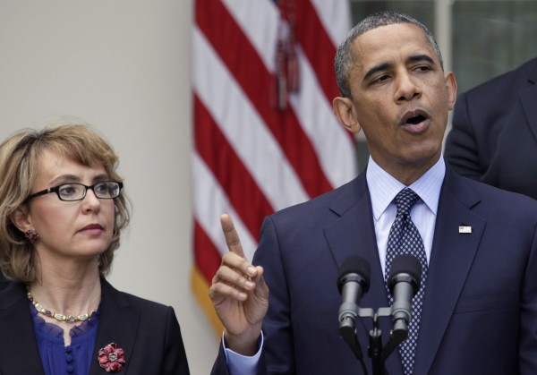 President Barack Obama speaks about gun violence next to former Rep. Gabby Giffords in the Rose Garden outside the White House on April 17, 2013.