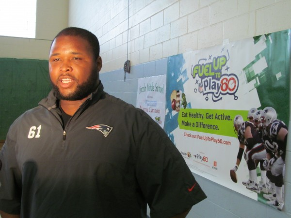 New England Patriots offensive lineman Marcus Cannon visits Lincoln Middle School in Portland Thursday to promote healthy food choices and exercise. Cannon's appearance was made possible through the Fuel Up to Play 60 program, organized by the National Football League and the National Dairy Council.