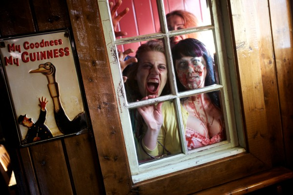 The undead Caitlin French (from left), Lindsay Robergea and Amy Baillargeon, want in at RiRa on Commercial Street in Portland Tuesday while out on a pub crawl, just for fun.