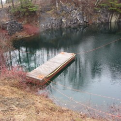 Car hauled out of water-filled Rockport quarry