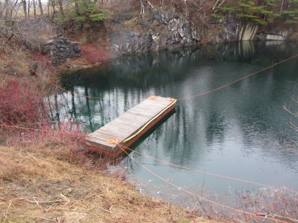 A car that drove into a water-filled quarry in Rockport earlier this month is scheduled to be raised by a crane Thursday.