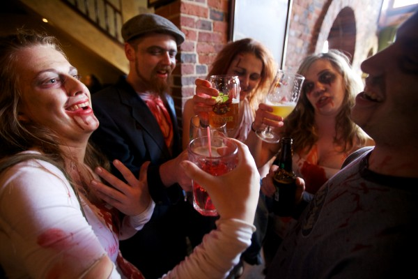 Zombies raise their glasses for a toast at Bull Feeney's in Portland Tuesday while on a pub crawl. The undead are Caitlin French (from left), Jessie Coates, Lindsay Roberge, Kelsey Woods and Sam Barron.