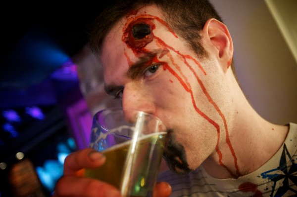 Ben Blaisdell sips a brew at Pat's Pizza in Portland Tuesday while out on a zombie pub crawl.