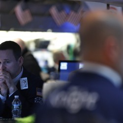 Wall Street ends up in volatile trade ahead of jobs data