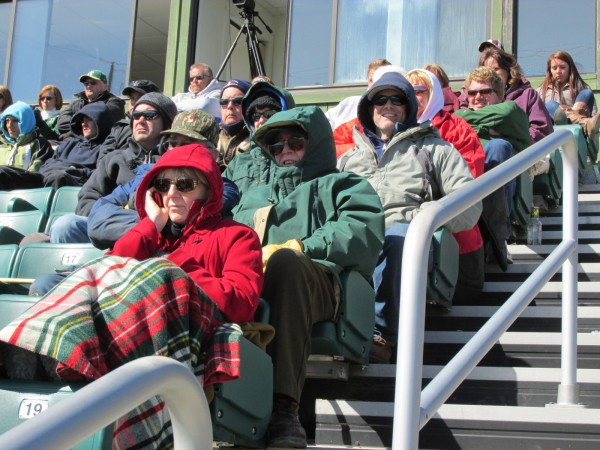 Approximately 75 hardy fans bundled up Saturday to watch Husson University's baseball doubleheader against Colby-Sawyer College at the Winkin Complex in Bangor. The teams also braved the cold, windy conditions.