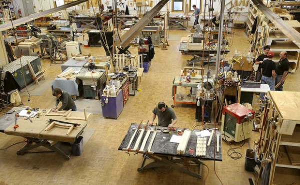 Craftsmen in the Thos. Moser Cabinetmakers factory in Auburn assemble furniture.