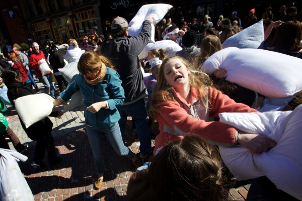 Participants swing away during Portland's first mass pillow fight Saturday afternoon, which was organized by Dispatch magazine. Similar events have been held annually in other cities around the globe since 2008.