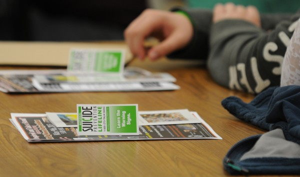 Suicide prevention material sits on a desk in front of teens that choose to atend a break out session and listen to information presented by Cheryl Morin and Raini Perry regarding their experiences as parents who lost teens to suicide.