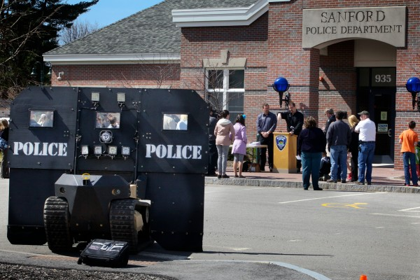 The Howe brothers, of Howe and Howe Technologies in Waterboro, speak to the media after demonstrating their remote tactical approach vehicle at the Sanford Police Department Thursday. Known as the &quotSWAT BOT,&quot the vehicle is designed to be bullet and explosive resistant and can be controlled remotely.