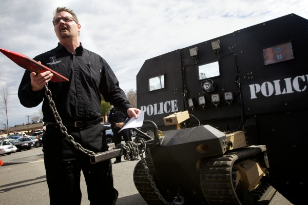 Mike Howe of Howe and Howe Technologies in Waterboro unveils the remote tactical approach vehicle at the Sanford Police Department Thursday. Known as the SWAT BOT, the vehicle is designed to be bullet and explosive resistant and can be controlled remotely.